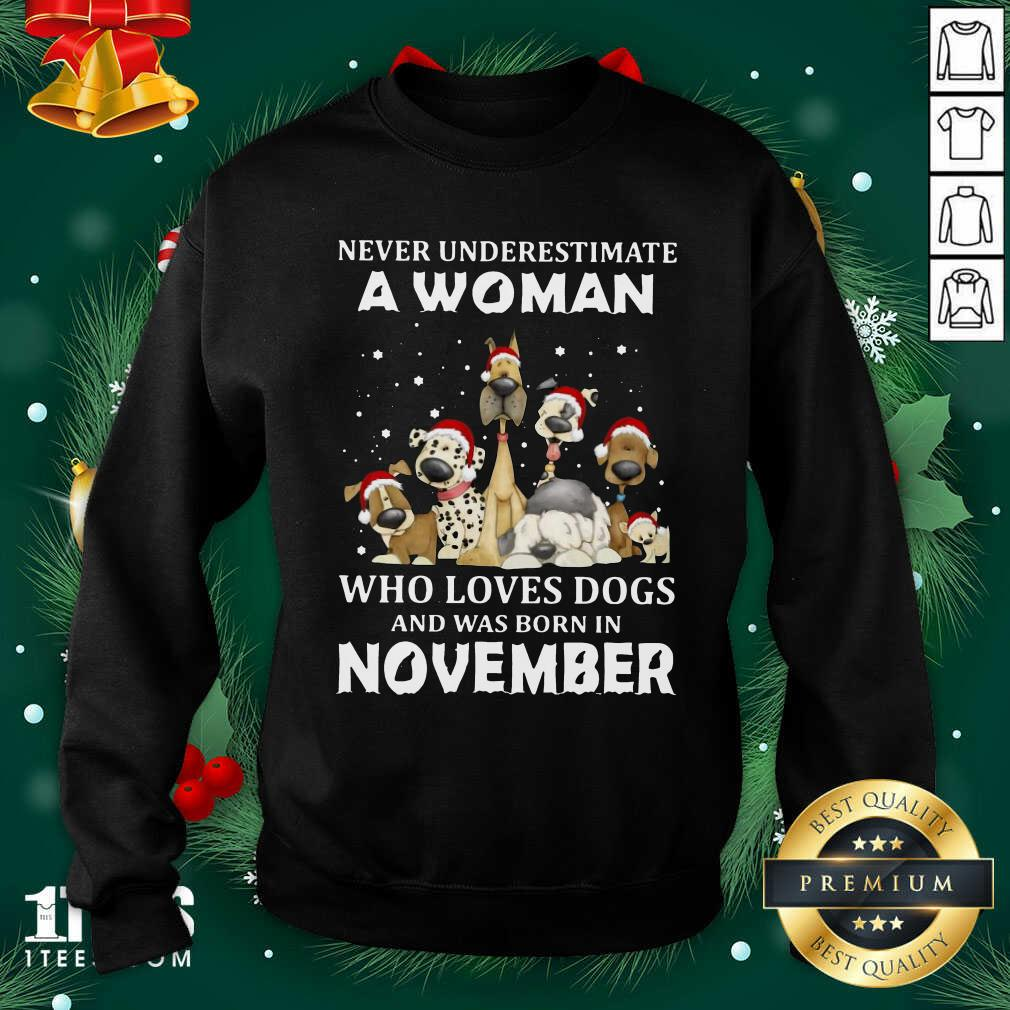 Never Underestimate A Woman Who Loves Dogs And Was Born In November Christmas Sweatshirt- Design By 1tees.com